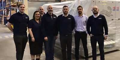 staff at MAG Laundry Equipment with primer es